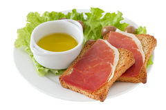 Toasts with prosciutto Stock Image