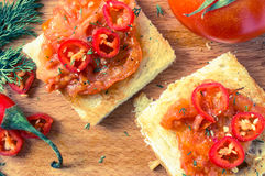 Toasts with roasted tomatoes Royalty Free Stock Photos