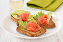 Toasts with salmon Stock Photo