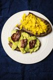 Toasts with scrambled eggs,  avocado and bacon Royalty Free Stock Photo