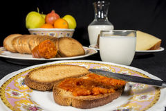 Toasts with sobrassada, milk, cheese and fruits Royalty Free Stock Photo