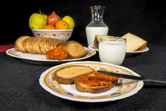 Toasts with sobrassada, milk, cheese and fruits Stock Images