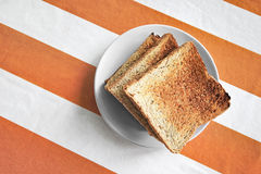 Toasts on tablecloth Stock Photography