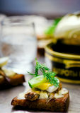 Toasts with tinned sprats Royalty Free Stock Photo