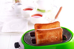 Toasts in a toaster, kitchen interior. Background Stock Photo