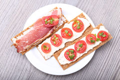 Toasts with tomato and bacon Royalty Free Stock Image