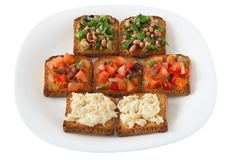 Toasts with tomato, beans and codfish Royalty Free Stock Photo