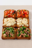 Toasts with tomato, beans and codfish Royalty Free Stock Photography