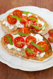 Toasts with tomato and cheese Royalty Free Stock Photography