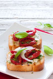 Toasts with tomatoes, basil and onions Royalty Free Stock Images