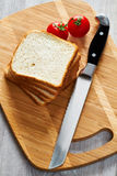 Toasts, tomatoes and knife Royalty Free Stock Photo