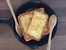 Toasts topped with Condensed milk on table stock image