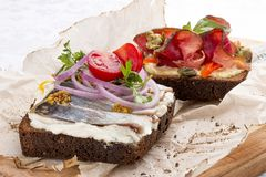 Toasts with venison, pepper and capers, herring and ricotta cheese stock image