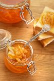 Toasts and orange jam in a glass jar Royalty Free Stock Photo