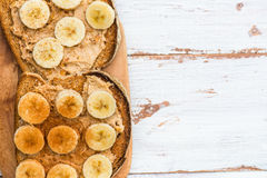 Toasts from Wholewheat Bread with Peanut Butter and Banana Royalty Free Stock Photos