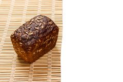 Toasty Organic Loaf of rye Bread on wooden plank isolated on white royalty free stock photography