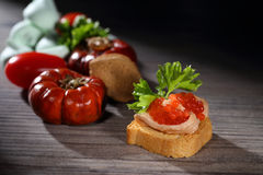 Toats with pate and caviar. On the table Stock Photography