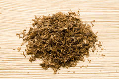 Tobacco. The brown tobacco on the board Stock Photo