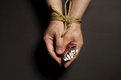 Tobacco addiction. Cigarettes on male hands tied with a rope Royalty Free Stock Photos