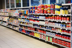 Tobacco aisle. MALMEDY, BELGIUM - JULY 2015: Shelves with Tobacco packings for home Cigarette tubing machine in a Carrefour Hypermarket Royalty Free Stock Photo