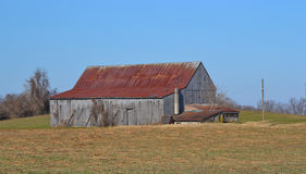 Tobacco Barn with Rusted Roof. Tobacco barn in Chaneyville, Calvert County, Maryland USA. The cultivation of the tobacco plant (Nicotiana tabacum) was a major royalty free stock images