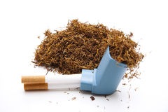 Tobacco with cigarets and Inhaler Stock Photo