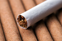 Tobacco in cigarette on dark cigarettes Stock Photos