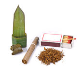 Tobacco,cigarette and food wrapped in leaves on white background Royalty Free Stock Photography