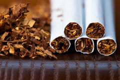 Tobacco and cigarettes. Macro of tobacco and cigarettes Stock Image