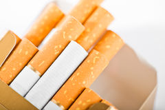 Tobacco in cigarettes. With a brown filter close up Royalty Free Stock Photos