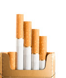 Tobacco in cigarettes with a brown filter. Close up Stock Photos