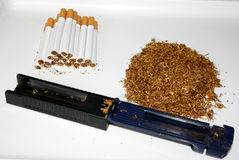 Tobacco and cigarettes. Making cigarettes at home Stock Photo