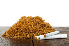 Tobacco and cigarettes. Pile of tobacco and hand-rolled cigarettes Stock Photography