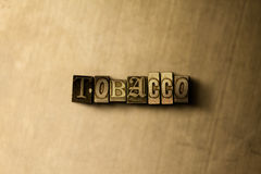 TOBACCO - close-up of grungy vintage typeset word on metal backdrop royalty free stock image