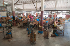 Tobacco factory. Many workers in one place make Cuban cigars on tobacco factory. CUBA TRINIDAD - 13 August 2015 Stock Photography