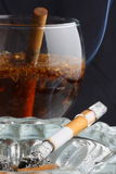 Tobacco flavored Tea and cigarette Royalty Free Stock Photo