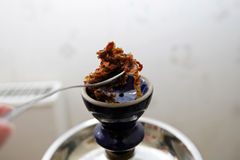 Tobacco for hooka. Preparation turkish hooka for smoking at home Royalty Free Stock Images