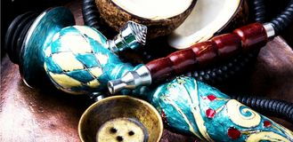 Tobacco hookah with coconut stock photography