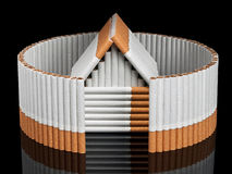The tobacco house behind not completed fence from cigarettes Royalty Free Stock Photos