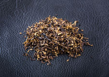 Tobacco on leather background Royalty Free Stock Image