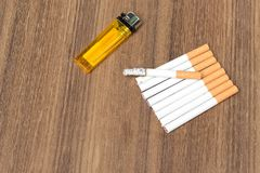 Tobacco and lighter,  burning cigaretter detrimental Stock Image
