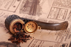 Tobacco pipe. On old paper Royalty Free Stock Images