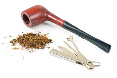 Tobacco pipe and cleaning tool Royalty Free Stock Photography