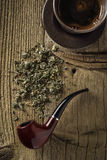 Tobacco pipe with coffee Stock Photos