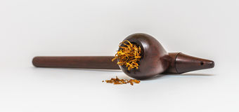 Tobacco Pipe. A handmade tobacco pipe with tobacco inside Royalty Free Stock Images