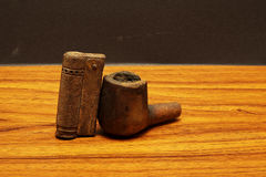 Tobacco pipe with lighter royalty free stock photography
