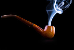 Tobacco pipe with smoke Royalty Free Stock Photos