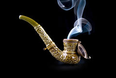 Tobacco pipe with smoke Stock Photo