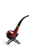 Tobacco pipe on a stand Royalty Free Stock Photos