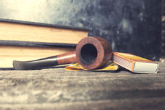 Tobacco pipe, tobacco and matches Stock Photography